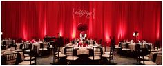 red black and white wedding reception, black chiavari chairs, red roses, red pipe and drape copyright @Kristin Vining Photography @Weddings and the City Charlotte, NC Wedding Photographer