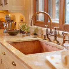 Beautiful Copper Sink, countertops, wood framed windows & cabinets.  Comfortable Elegance: Meredith Vieira's Home - Traditional Home®