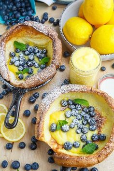 Dutch Babies with Lemon Curd and Blueberries Light and fluffy, cloud like, dutch baby pancakes filled with lemon curd and fresh blueberries! - Dutch Babies with Lemon Curd and Blueberries Delicious Desserts, Yummy Food, Tasty, Yummy Drinks, Brunch Recipes, Sweet Recipes, Cheap Recipes, Easter Recipes, Pancake Recipes