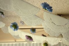 this is a cute vintage looking garland and a good way to use up the doilies we have