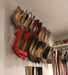 High heel shoe racks made from crown molding- good idea for the opposite wall in walk in wardrobe - space saving.