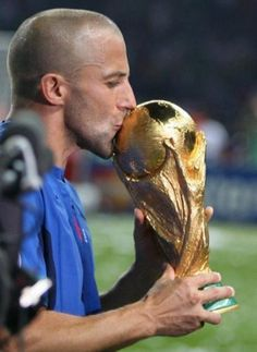 Alessandro Del Piero kissing the 2006 FIFA world cup he won with Italy in the final against France (2006)