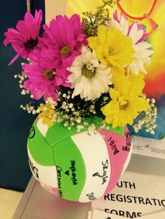 My daughter is OBSESSED with volleyball!!! I made this vase for her coach & had the team sign it... Items used: Volleyball, dollar tree vase, scissors, x-acto knife, permanent marker, fresh bouquet of flowers.. Easy PEASY!!
