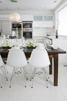 love this white kitchen w/dark wood farm table; modern aesthetic