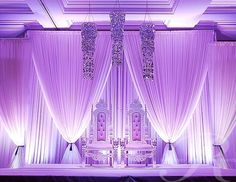 lilac lighting and white backdrops and draping.... SO NICE!!!