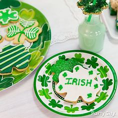 "These cookies are begging for a kiss! Whip up these ""Kiss Me, I'm Irish"" cookies with shamrock cookie cutters, icing and sugar sprinkles!"