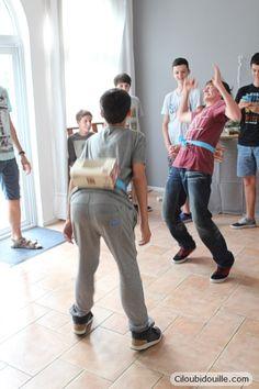 Anniversaire pour adolescents | Ciloubidouille : idées activité se déhancher pour faire tomber les balles de ping pong de la boîte