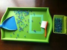 Sweeping tray, practical life skill. You could use marbles or any small ball. Get a brush and pan from the dollar store. Simply DIY motor activity.