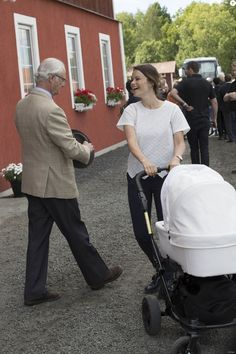 Prince Carl Philip of Sweden, Princess Sofia and Prince Alexander in strollers during the day of Stenhammar, the area of the castle Sten.