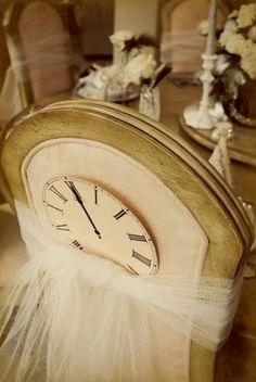 decorate backs of dining chairs with tulle clocks for a new years eve themed dinner party from whimsy november