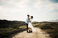 Ashley & Rob celebrate being engaged on the rolling grass hills in Orange County, California.