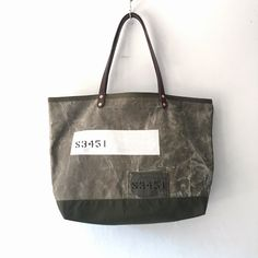 50's US Army vintage canvas remake tote bag. Very nice fade, original color is Olive drab. For bottom parts I use vintage shelter half tent fabric. Very nice vintage condition.  IND_BNP_0444 W 53cm H 33cm D14cm Handle 55cm
