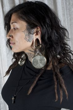 Diablo Organics Pyrite Disc Ear Weights for the elegantly hardcore Diablo Dames with stretched ears.  App Conference in Vegas, 2014.  Designed by Jimmy Buddha and photographed by Kelly Hawkins.
