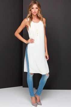 With a cute top like the Catch Twenty Tunic Ivory Maxi Top, there's no way you can lose! This gorgeous maxi top has a lightweight woven fabric with a round neckline and darted bodice. Top drapes down to an extra-long length with side slits, and a back keyhole fastens with a silver spike-shaped button. Unlined. 100% Viscose. Dry Clean Only. Imported.