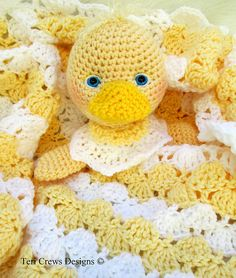 Ravelry: Duck Huggy Blanket pattern by Teri Crews.  ~ PATTERN FOR SALE. Link correct when I checked on 04/07/2015