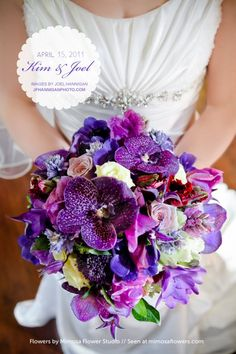 Purple Vanda orchids, clematis, parrot tulips, freesia, hyacinth, roses, lisianthus and trachelium bouquet