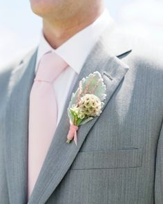 Textured Boutonniere: This boutonniere features lambs' ear and scabiosa tied with pink velvet ribbons and pinned to lapels for a modern look with plenty of depth.
