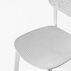 The chair is designed in perforated polypropylene, curved wood and padded with fabric or leather upholstery.
