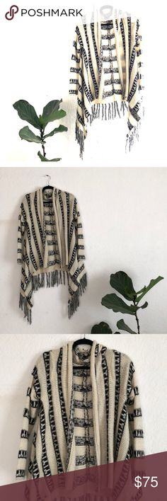 Boho Chic Patterned Wrap from Spain Black and white wool wrap with fringed edge. Bought on a trip to Barcelona. Super cute over black top and jeans. Be fashion ready on any adventure — desert trip, beach at night, camping.  Q Sweaters Shrugs & Ponchos