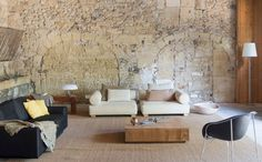 Loft in Aimargues by Studio76 Architetti Associati | HomeAdore - Those cool stone arches!!