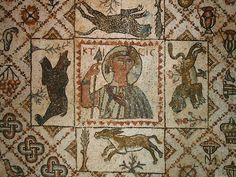 Fifth century Byzantine mosaic of the goddess Ktisis (KTICIC), a bear, a lion, a leopard, and a donkey on a background of urns, ducks, berries, flowers, and crosses, preserved at the Beiteddine Palace in Lebanon.
