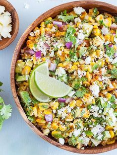 Mexican Street Corn Salad with Avocado is always a crowd-pleaser! It's fast and easy to prepare, and has a tasty balance of fresh flavors and textures. Serve it cold, warm, or at room temperature. #mexican #mexicanfood #salad #streetcorn #easyrecipe #corn #entertaining #potluck | aseasyasapplepie.com