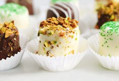 Chocolate  Dipped Marshmallows are simple to make, and delicious to eat. Easy, and so many options. This middle one shown here is rolled in chopped pistachios... mmm.