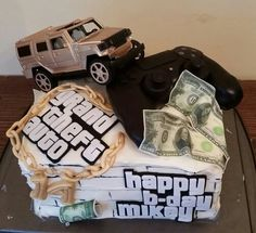 Grand theft auto cake. Everything but the truck is edible. The controller turned out so good, the birthday boy was mad at first because he thought his controller had frosting all over it.
