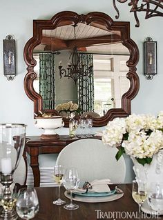 Love the shape of this mahogany mirror from #centuryfurniture - Traditional Home® / Photo: John Bessler / Design: Mary O'Brien Cabaron