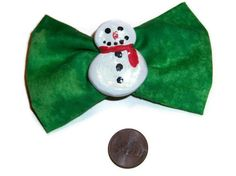 This festive hair bow will definitely add some holiday cheer to your day! The bow was created using a lovely bright green fabric. The snowman was hand formed using sculpey oven-bake clay. He was formed by hand, no molds were used. After baking, he was then hand painted using acrylic paints and covered in a sheer gloss.