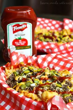Loaded Cheeseburger Fries | These french fries are loaded with everything it takes to make a great cheeseburger. Ground beef, onions, pickles, cheese, and of course ketchup and mustard. Loaded Cheeseburger Fries are an awesome game day appetizer recipe for your next football party or a weeknight meal for the family. This loaded french fry recipe is going to blow your mind!