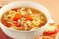 This our favorite version of a comfort food classic - a richly flavored chicken broth with carrots, celery, diced tomato, shredded cabbage and broad egg noodles.