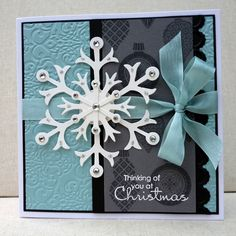 Snowflake die used then added bling with rhinestones & silver dazzling details. Grey panel stamped with small ornaments from Ornament Keepsakes & the sentiment was stamped over the top with Versamark then embossed with white EP. Border die cut in black cardstock with an edgelit die & embossed with coordinating embossing folder. Baja Breeze background was embossed with Lacy Brocade embossing folder & some Baja Breeze seam binding added to finish.