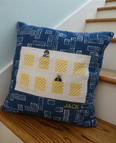 This Lego pillow is such a neat storage/decor/snuggle gift.  Eight little minifigure guys will be stashed safely and the boys beds will look pretty nifty.  And it was made using what I had on hand- here's how...