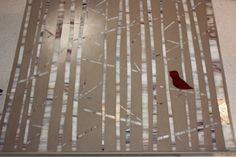 Red Bird in Birch Trees, stained glass mosaic art by Melanie Cummings - original mosaic wall hanging made using hand cut stained glass encased in two different colors of grout: background of light grey-taupe color w/ the sun peaking through the forest in pale creamy white grout blending out into the darker grout. All colors are neutral, except the cranberry bird - $ 350-- , via Etsy.