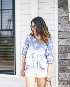Blue and white floral top with white Levi 501 shorts