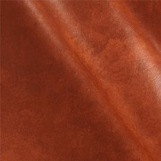 """Faux Leather Caprice Bourbon from @fabricdotcom  This upholstery weight faux leather fabric has a nylon mesh backing.  This versatile fabric can be used for upholstery projects,  picture frames, pillows, headboards craft projects, purses, fashion accessories and more!   California residents click  <a href=""""http://prop65.fabric.com/"""">here</a> for Proposition 65 information."""