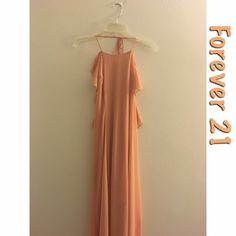 "$9 for today: Halter maxi dress Forever 21 flounced halter maxi dress. Size: Large. Fits fitted over a flowy overlay. Includes a half slip that comes above knee. Color: Salmon. Appears peach in photo, but is more light coral in photo. 100% Polyester. Measured from chest: 30"". From bust to hem: 56"". Note: there are two very slight dark marks due to washing on sides of dress (in photo 3). Forever 21 Dresses Maxi"