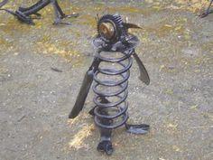 Penguin garden art  with large metal spring