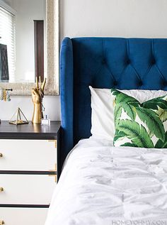 Bedroom Progress - blue head board, banana leaf pillow