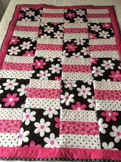 This is a machine sewn pretty Floral inspired cotton quilt/throw.Floral quilt, flowers, baby blanket, baby quilt, Michael Miller fabric by Ladylovesfabric on Etsy It measures 41 by 58 inches.for idea i may use recycled girls boys clothes.Gina and Mal Baby Girl Quilts, Quilt Baby, Boy Quilts, Girls Quilts, Rag Quilt, Baby Quilts Easy, Quilts For Kids, Baby Patchwork Quilt, Amish Quilts