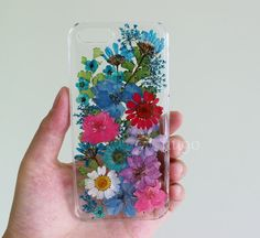 These cases are my own design. This is handmade item, This is Real Dried Flower and Leafs on the back of your case. The back is resin, the back smooth. We