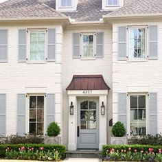 White Brick House with Light Blue Shutters Painted Brick Exteriors, Exterior Makeover, House Painting, Painted Brick House, White Brick Houses, White Brick, Colonial House, Paint Colors For Home, House Exterior