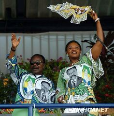 President of Gabon El Hadj Omar (born Bernard-Albert) Bongo Ondimba and his third wife Edith Lucie Bongo Ondimba (who was also the daughter of Congo-Brazzaville's President/dictator Denis Sassou-Nguessou) celebrate his last election victory in 2005.  They both died in 2009, he having been head of state since 1967 and among the closest allies of former colonial power, France.          Note: it is tacky -- at least in my opinion -- to wear a commemorative print of yourself. Lady Diana, African Prints, African Fabric, Political Culture, Textile Texture, Head Of State, African Clothes, Nelson Mandela, Victorious