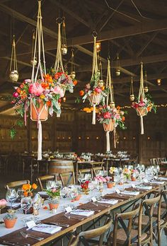 Colorful chandeliers in unique planters create a Moroccan vibe | Brides.com