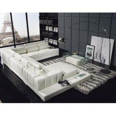 White Leather Sectional Sofa with Built-In Lighted Glass End table.