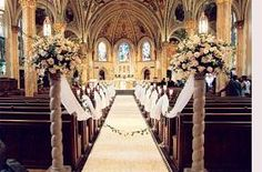 Church Wedding Decorations ( red black and gold flowers with red drapes and black  with gold for the stands.