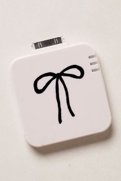 Bowknot Backup iPhone Battery - Anthropologie.com ( need one for the 5!)