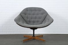 Vintage Mid-Century Swivel Lounge Chair by George Mulhauser | From a unique collection of antique and modern lounge chairs at https://www.1stdibs.com/furniture/seating/lounge-chairs/