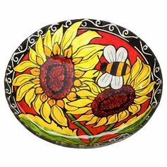 "Display this beautiful glass bowl on a console table, or showcase as a birdbath in your garden-the multicolor bee and sunflower designs add artisan appeal to any decor.   Product: Birdbath bowlConstruction Material: GlassColor: MultiDimensions: 5.5"" H x 17.69"" Diameter"